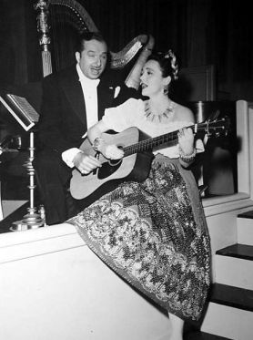 Xavier Cugat and Lina Romay entertain during a lull in the day´s shooting on the set of Week-End at the Waldorf. 1945
