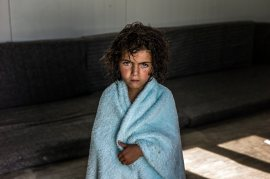 Jordan / Syrian refugees / Portrait of a young syrian refugee taken in her mobile home in the Zaatari's camp in Jordan. / UNHCR / O. Laban-Mattei / June 2013