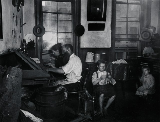 Bohemian Cigarmakers at work in their Tenement. Via Preus Museum